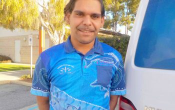 Young Indigenous man in blue shirt
